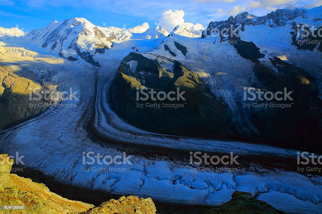 Monte Rosa massif, Gorner glacier crevasses sunrise, Swiss Alps stock photo