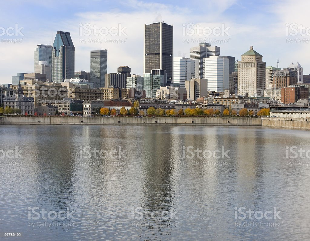 Monteal skyline reflected in St. Lawrence River royalty-free stock photo