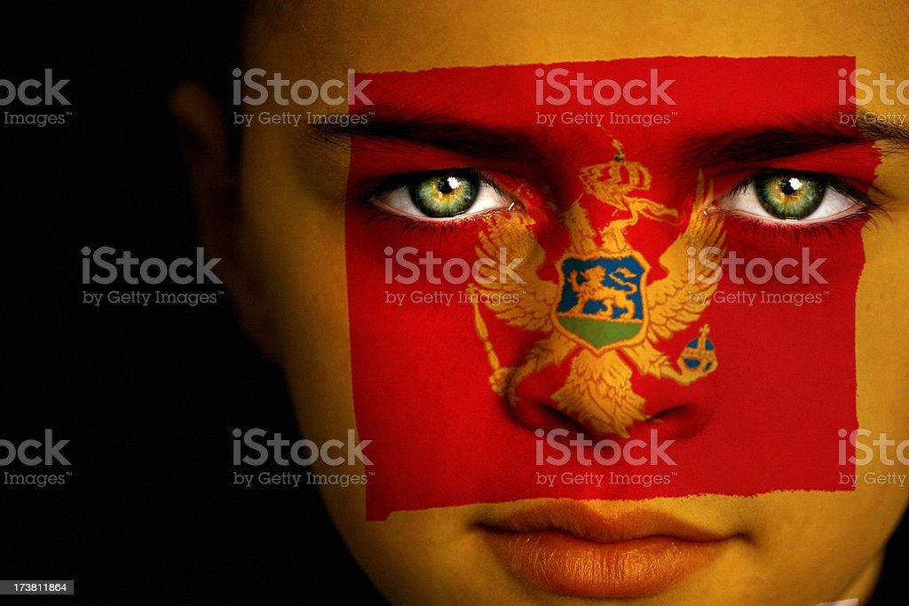 Montenegro flag boy royalty-free stock photo