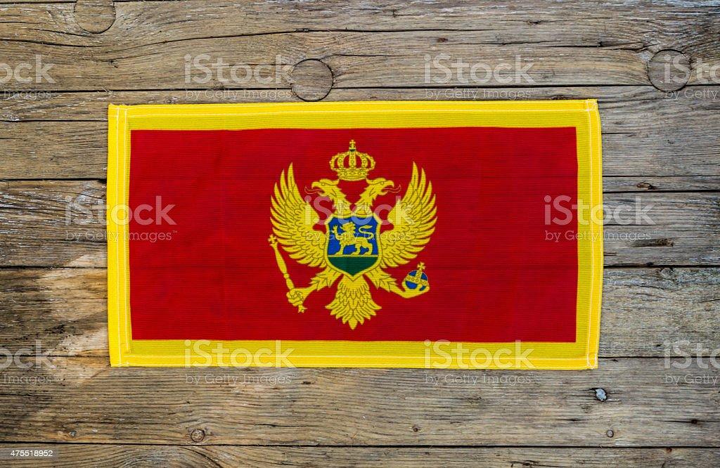 Montenegro flag on wooden background stock photo