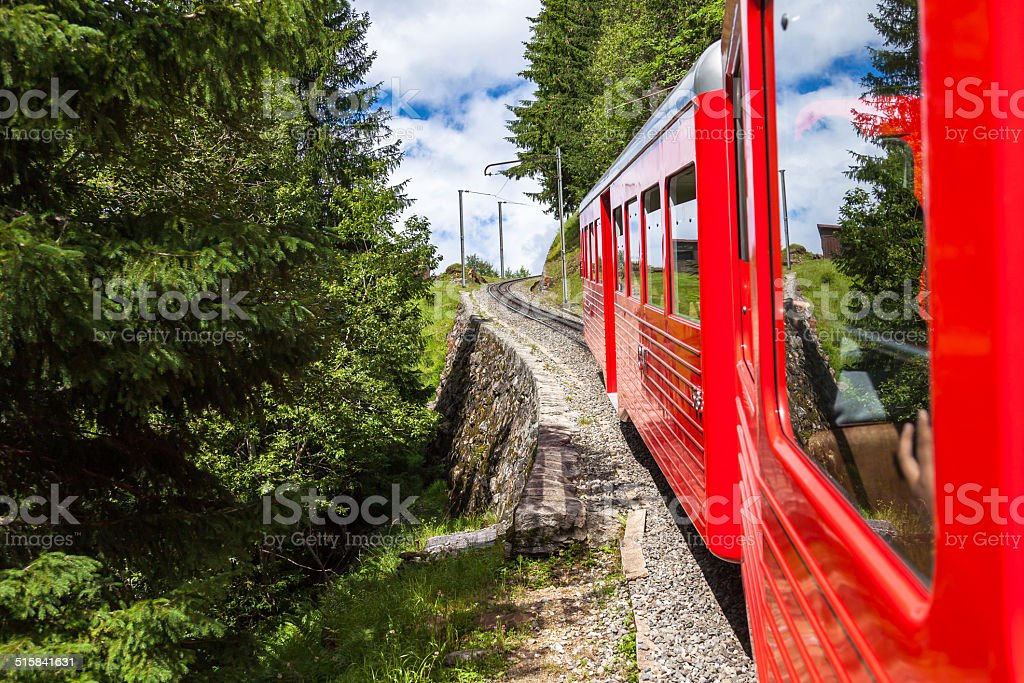 Montenvers  red train taking to Chamonix ice sea in France stock photo