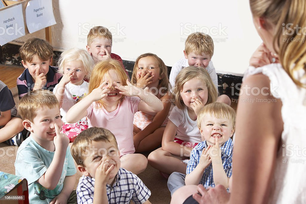 Montessori/Pre-School Class Listening to Teacher stock photo