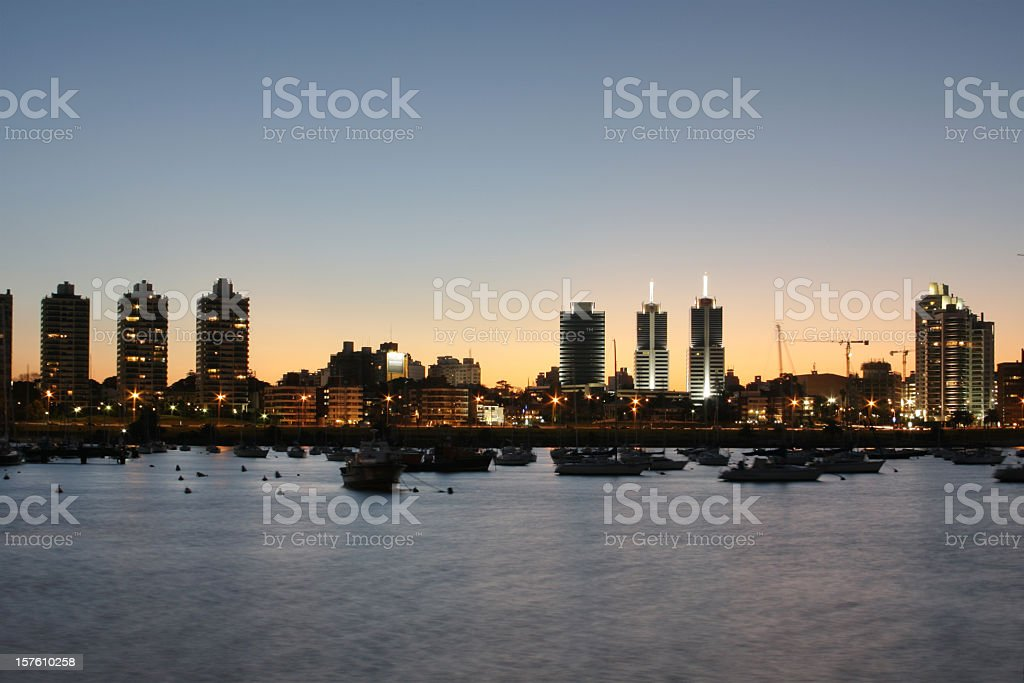Montevideo cityscape at dusk from a marina stock photo