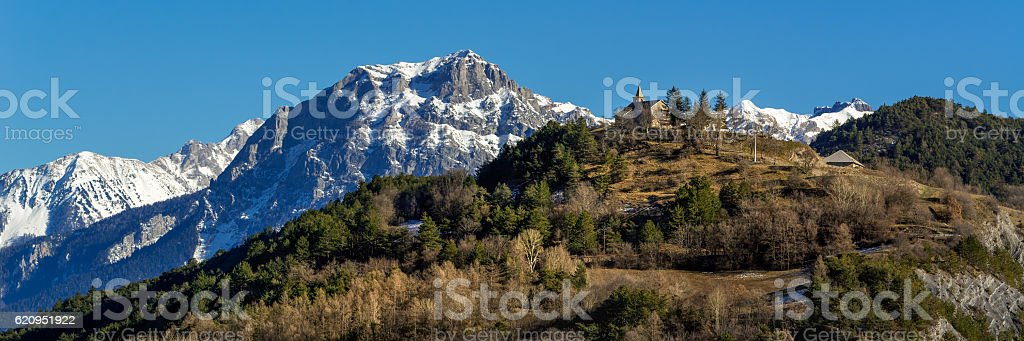 Montgardin village church and Pic Morgon in Winter, Alps, France stock photo