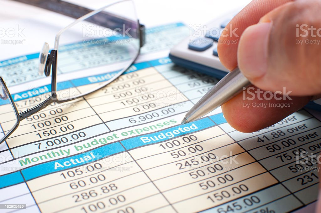 Monthly budget list with calculator and glasses royalty-free stock photo