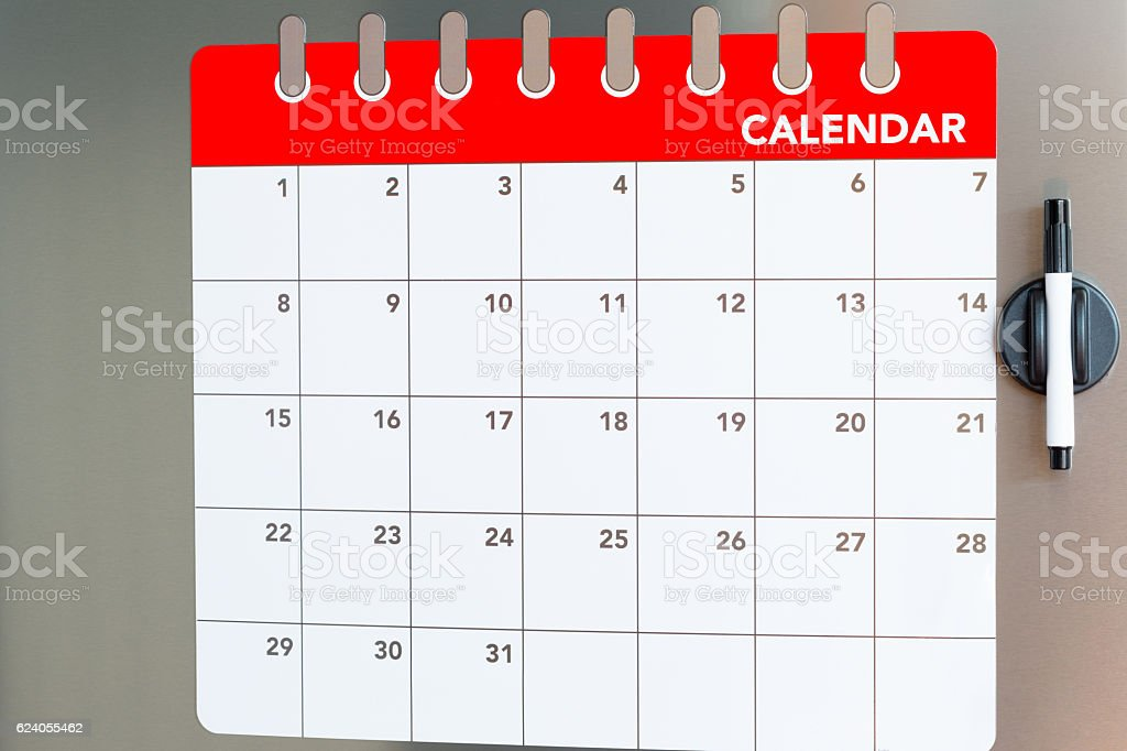 Monthly calendar in the fridge stock photo