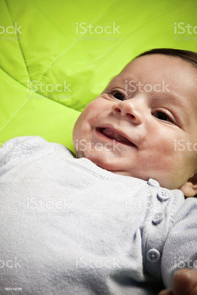 4 Months Baby Lying On The Quilt stock photo