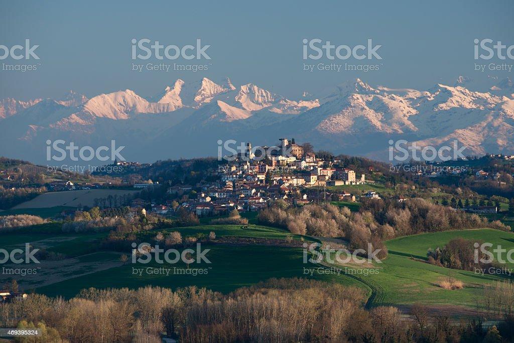 Montiglio Monferrato, the snow covered Alps on background, hilly landscape stock photo