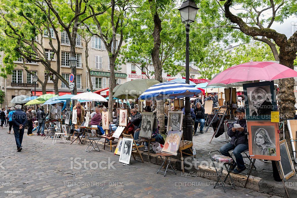 Montmartre with street artists ready to paint tourists, Paris stock photo