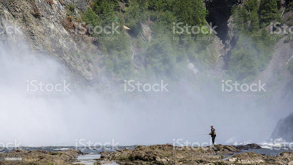 Montmorency Falls, Quebec City, Canada, Fishing, Fisherman. royalty-free stock photo