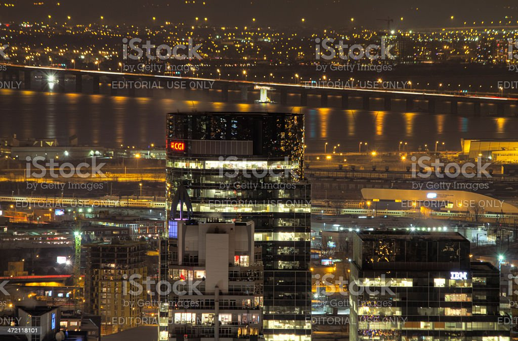 Montreal night skyline with head office of CGI Group inc. stock photo