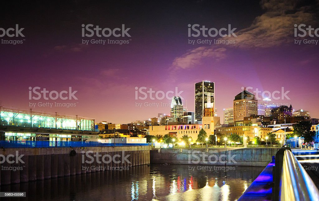 Montreal Old Port at night in Summer from piers stock photo