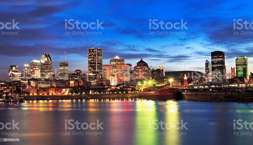 Montreal skyline and St Lawrence River at dusk stock photo