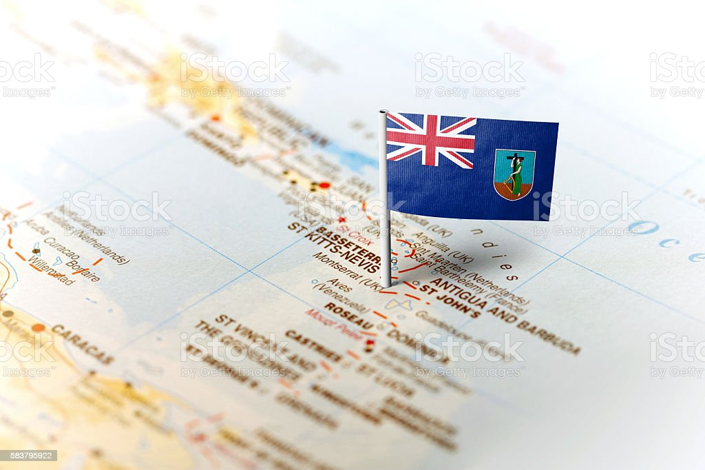 Montserrat pinned on the map with flag stock photo