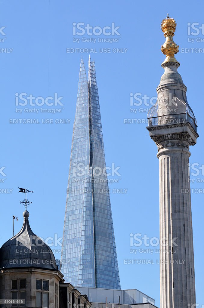 Monument In City of London against The Shard skyscraper stock photo