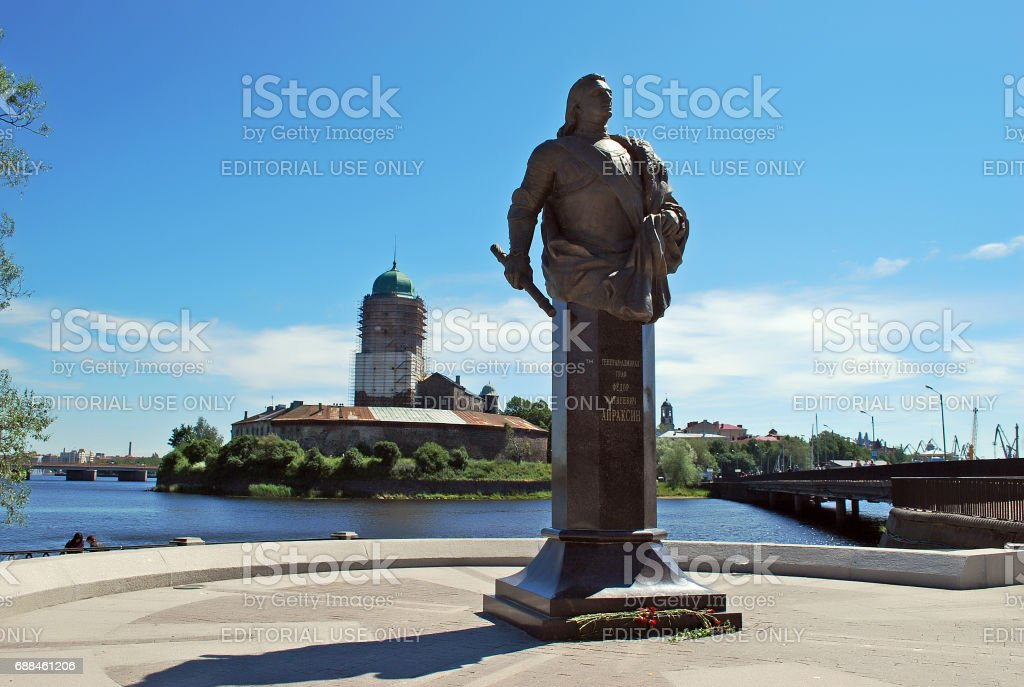 VYBORG, RUSSIA - JULY 26, 2016: Monument of count F. M. Apraksin (1661—1728) with the Vyborg castle on the background in stock photo