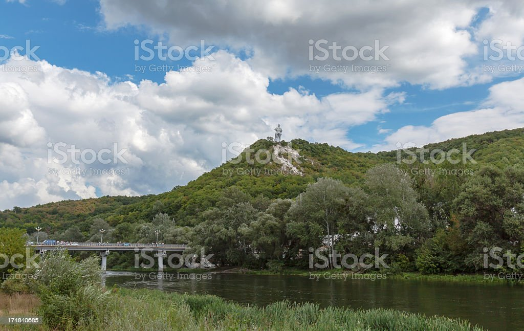 Monument on hill over the river stock photo