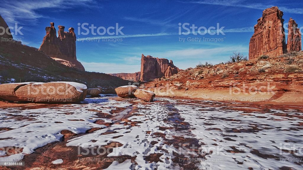Monument Rock Formation, Melting Snow, Ice, Springtime, Arches National Park stock photo