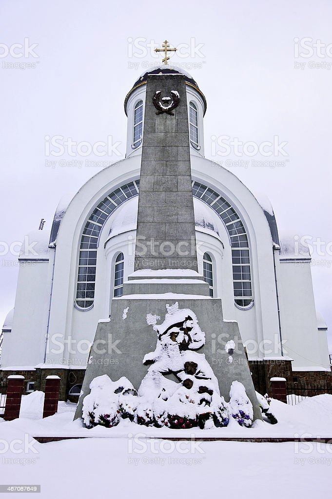 Monument to fallen in World War II against Christian church stock photo