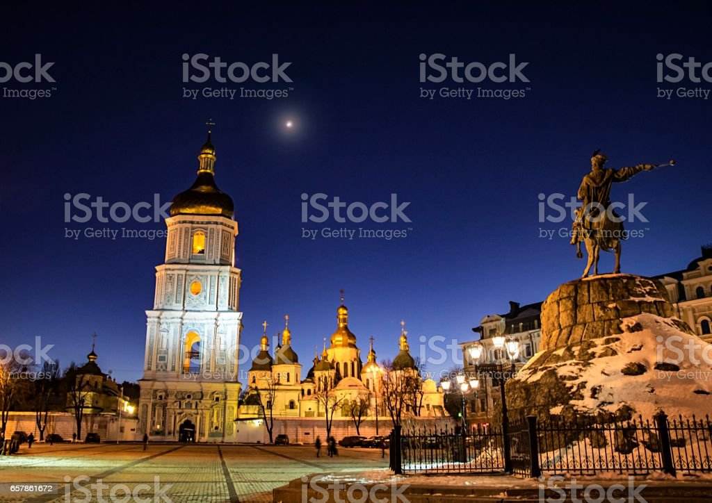 Monument to hetman of Ukraine Bogdan Khmelnitsky and Sofia Cathedral a night stock photo
