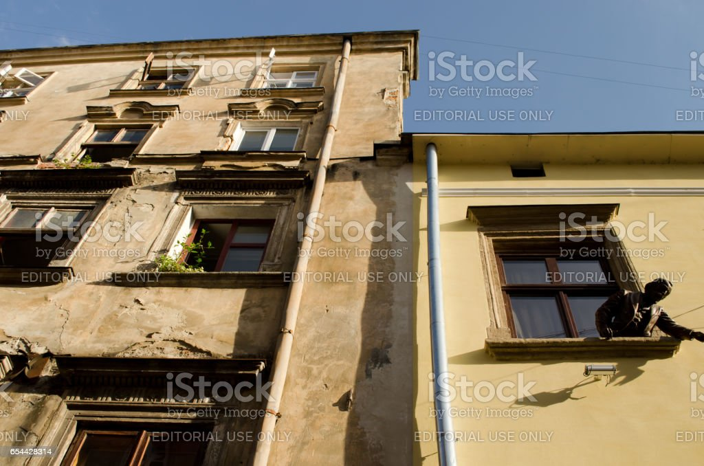 Lviv, Ukraine - July 20, 2014: Monument to inventors of an oil lamp, to the Lviv druggists Ignatiy Lukasiewicz and Jan Zegu.  Lviv — the city of regional submission in Ukraine, the regional center of the Lviv region. stock photo
