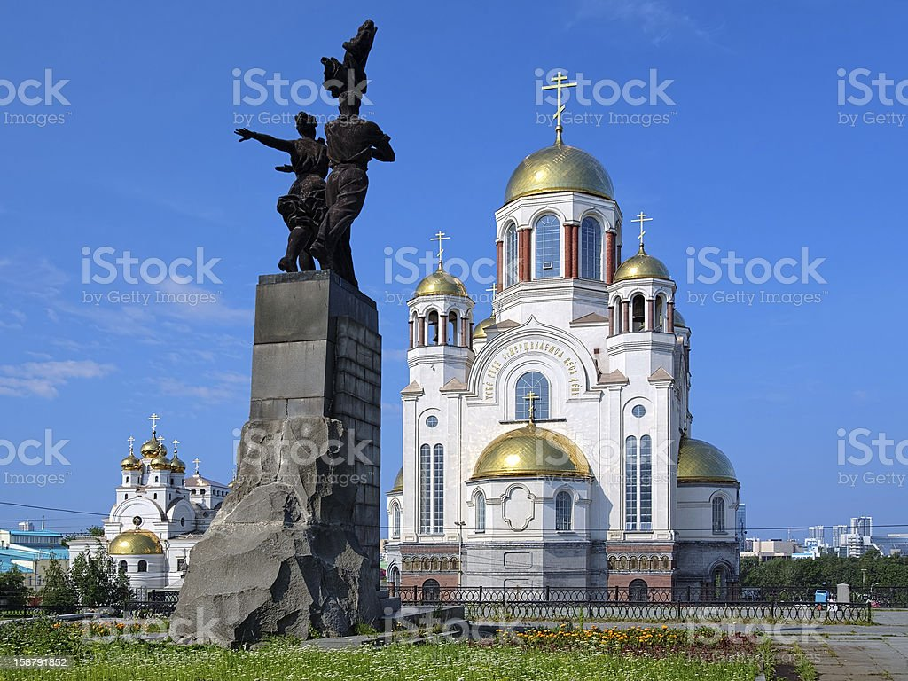 Monument to Komsomol of Ural and churches in Yekaterinburg stock photo