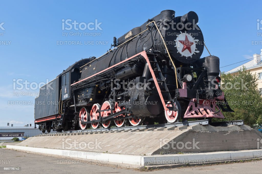 Monument to locomotive-worker L-5129 at the station square in Kotlas, Arkhangelsk region stock photo