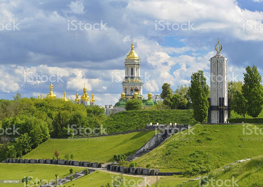 Monument to victims of Holodomor and Kiev-Pechersk Lavra in Kiev stock photo