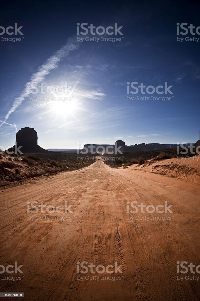 Monument Valley Desert Country Road Against Vivid Blue Sky royalty-free stock photo