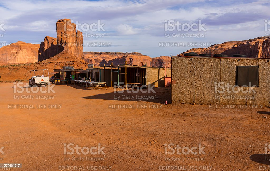 Monument Valley. Huts of souvenir sellers with guide's pick-up stock photo