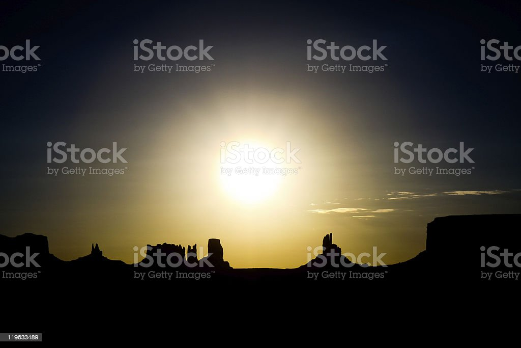 monument valley silhouette at sunrise stock photo
