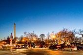 Monument with Pennsylvania avenue and 15t street during sunset