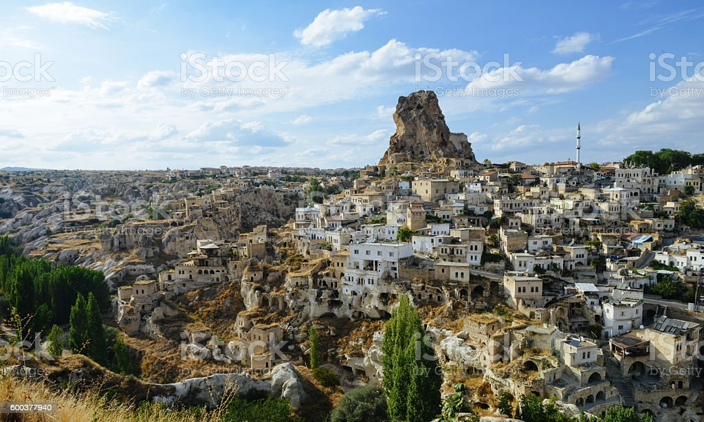 Monumental ancient Ortahisar castle under blue sky in Cappadocia, Turkey royalty-free stock photo