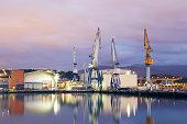 Monumental Cranes at sunrise in Shipyard.