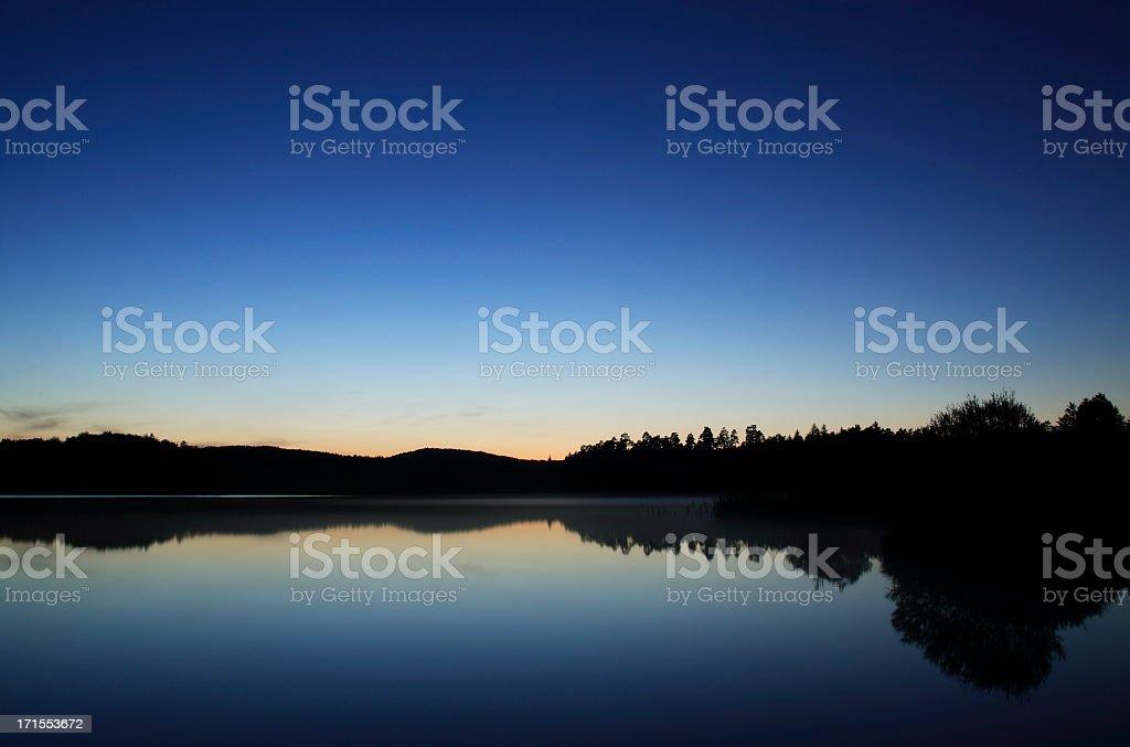 Moody Lake after Sunset royalty-free stock photo