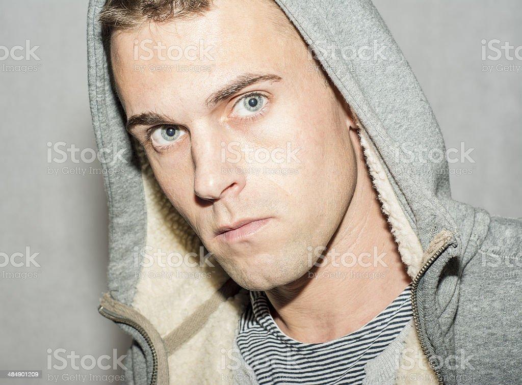 moody male wearing hood stock photo