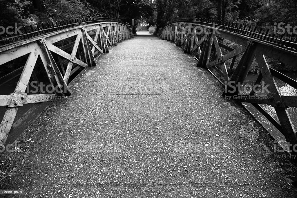 Moody old iron bridge over the River Thames, stock photo