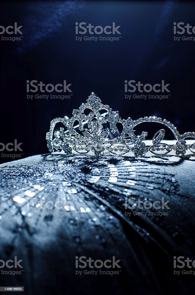 Moody photo of a tiara presented on a pillow stock photo