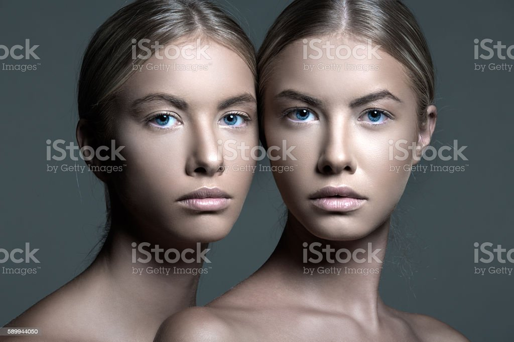 Moody Portrait of a Beautiful Twins stock photo