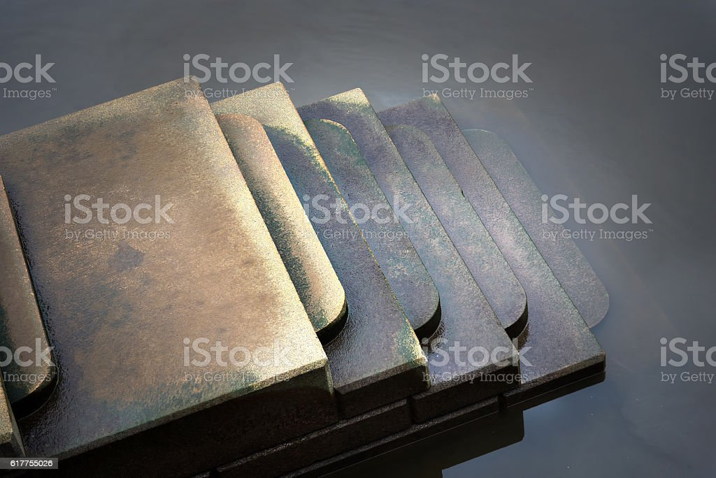 Moody scene of steps leading down in ominous water. stock photo
