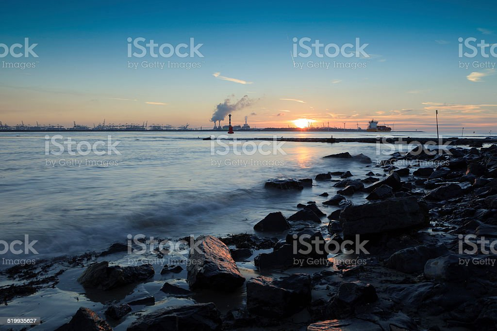 moody seascape along the Nieuwe Waterweg river stock photo