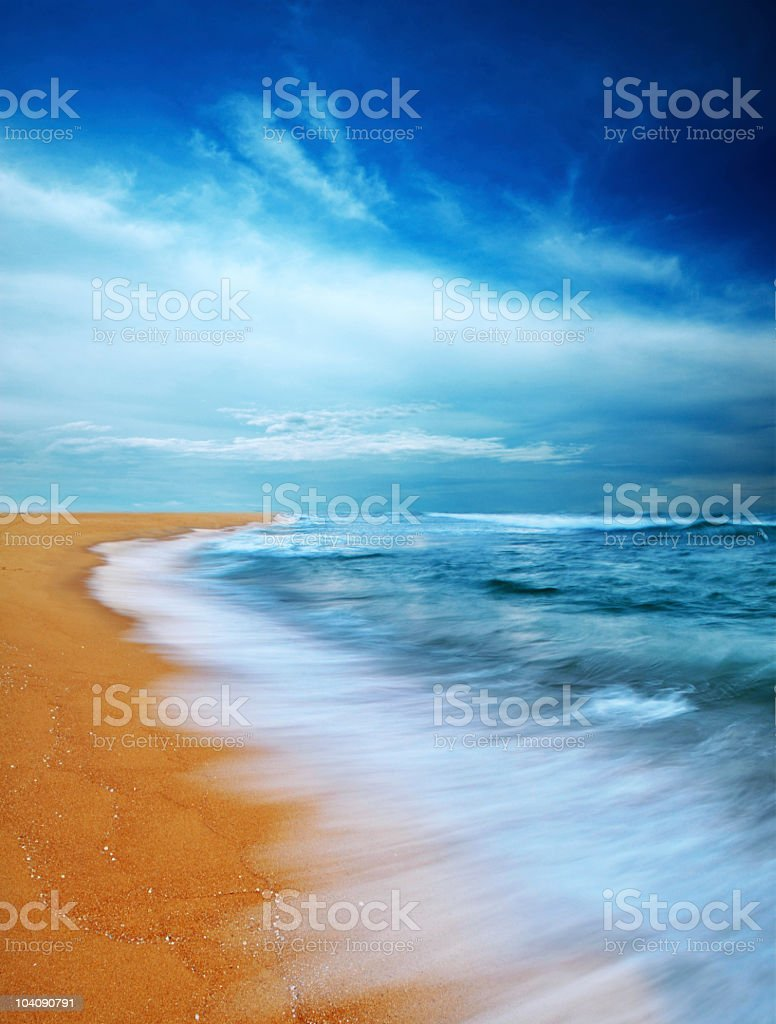 Moody sky and beach royalty-free stock photo