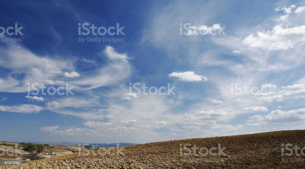 Moody sky on plowed land royalty-free stock photo