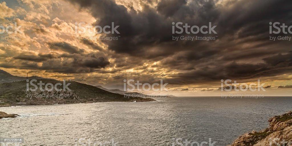 Moody sky over the coast of Corsica near Ile Rousse stock photo