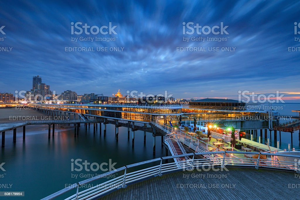 moody sky over the Pier of Scheveningen stock photo
