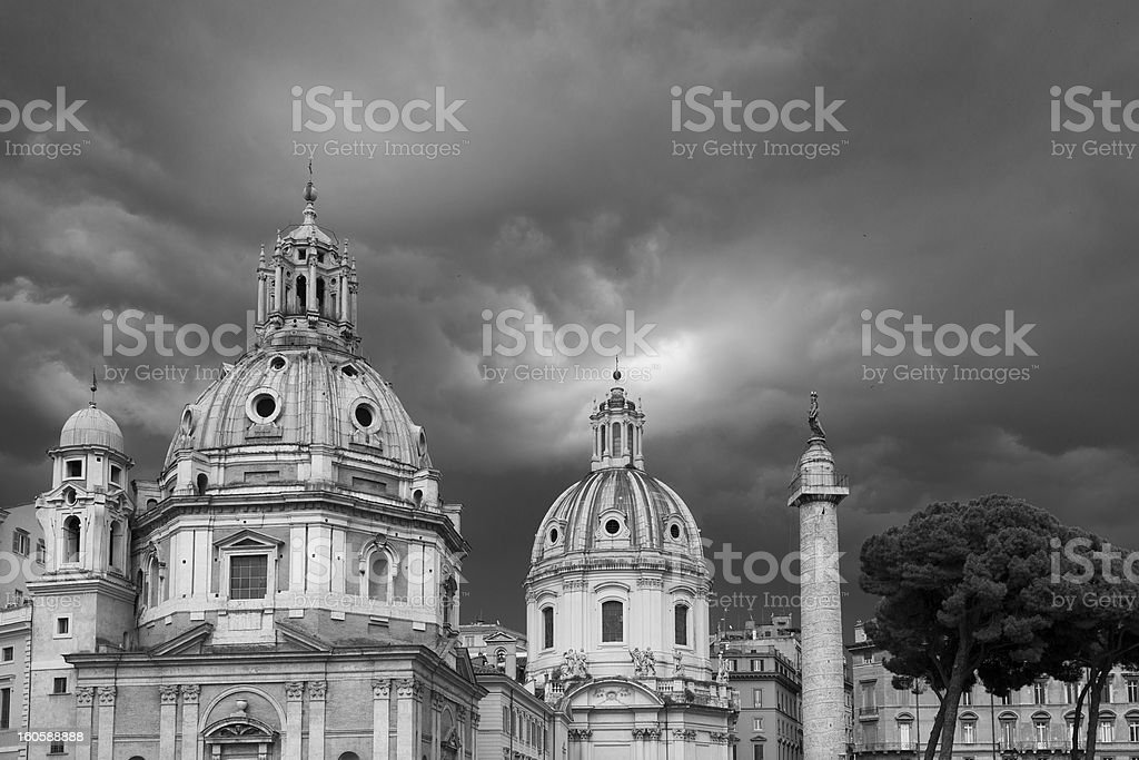 Moody sky over Twin Churches and Trajan's Column in Rome royalty-free stock photo