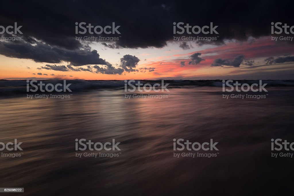 Moody sunset over the baltic sea photographed with long exposure stock photo