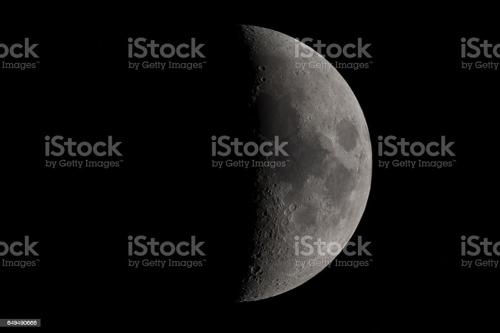 Moon almost in the third quarter phase on 5.3.2017 stock photo