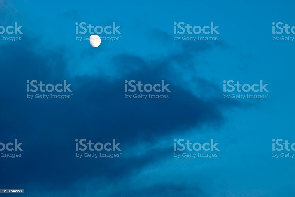 Moon and cloud in a winters sky, Isle of Lewis stock photo
