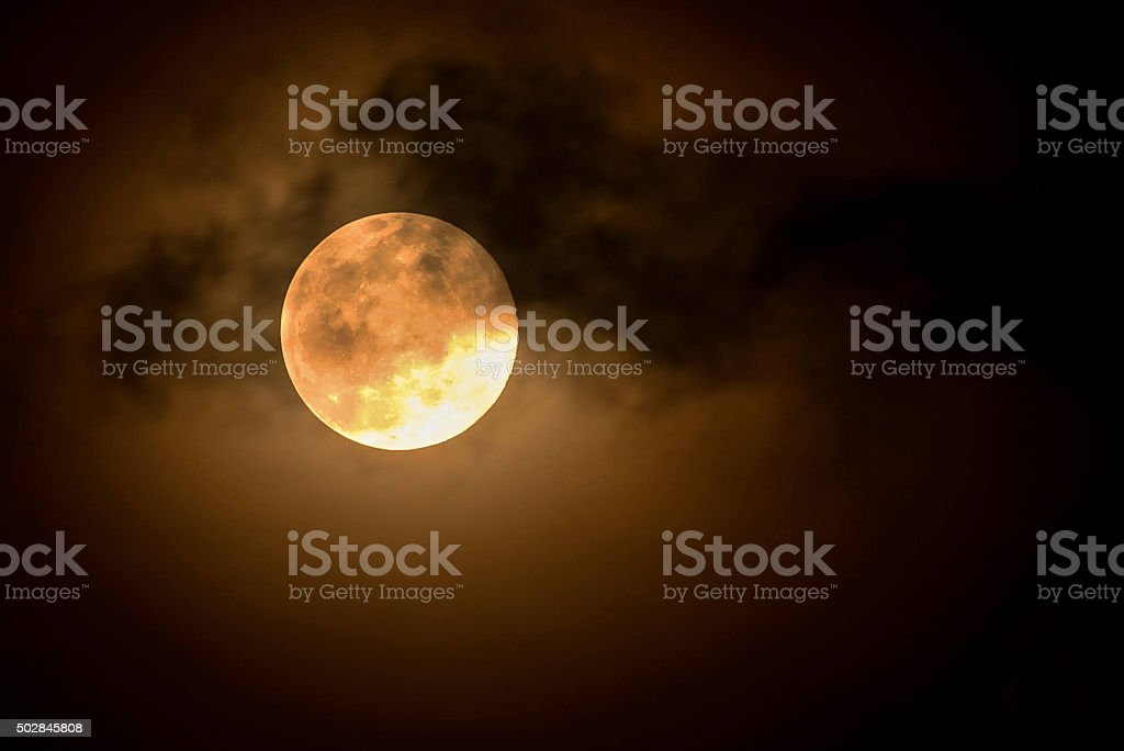 Moon and dark clouds in night stock photo